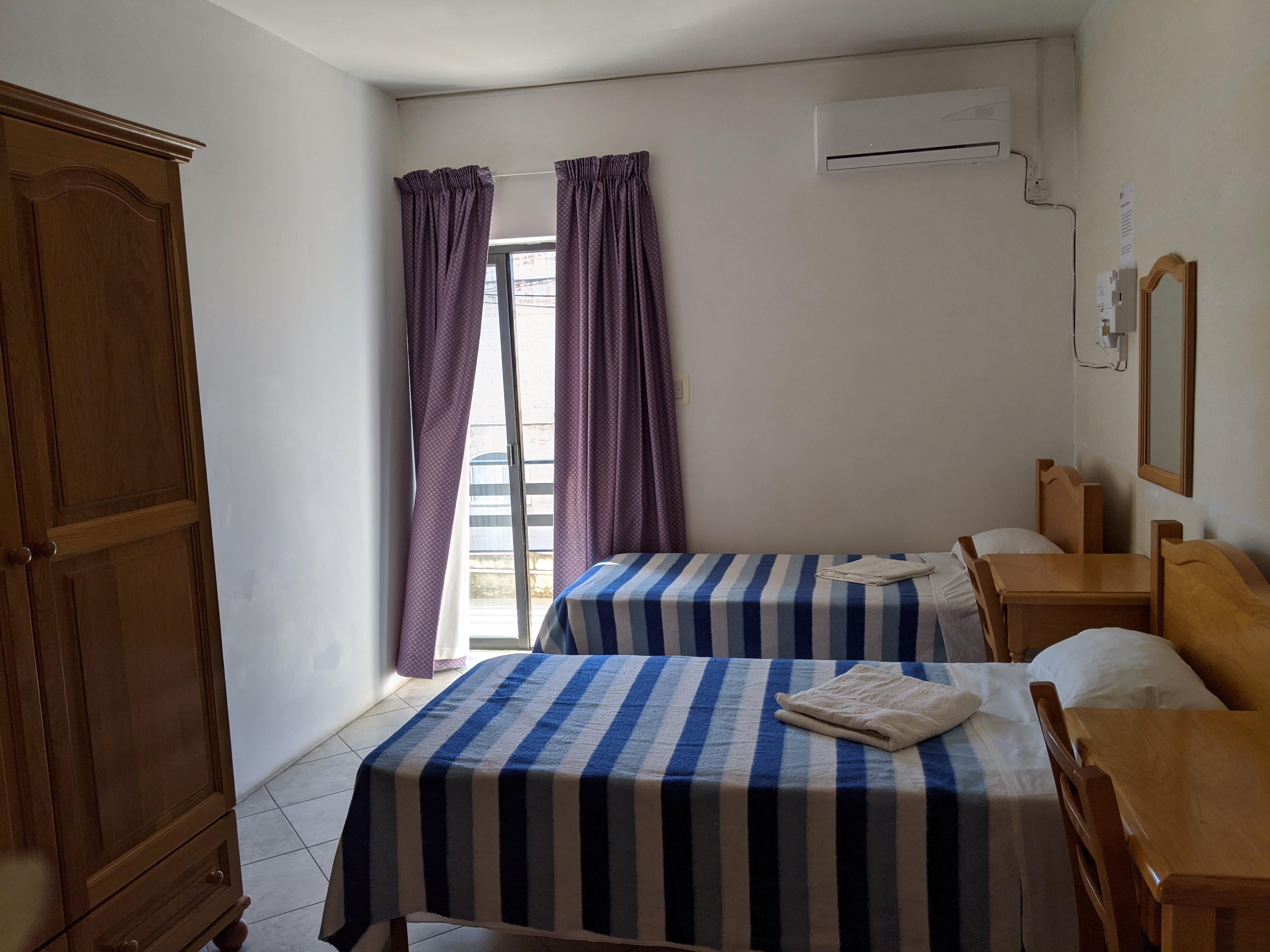 les chambres du logement à côté de l'école d'anglais à Malte Gateway gse residence in st julians
